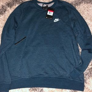 NWT, Nike pullover with front pouch. Standard fit